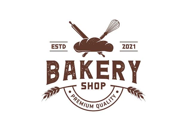 泡立て器と麺棒、ヴィンテージベーカリーのロゴデザインのインスピレーションテンプレート