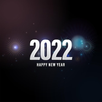 White 2022 happy new year text on fireworks black background.