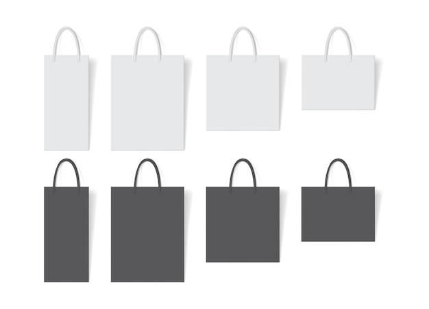 Белый и черный бумажный пакет на белом фоне