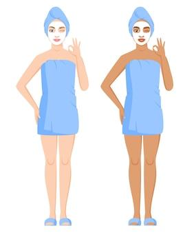 목욕이나 샤워 후 수건으로 싸인 백인 및 흑인 여성 화장용 점토 또는 시트 마스크 사용