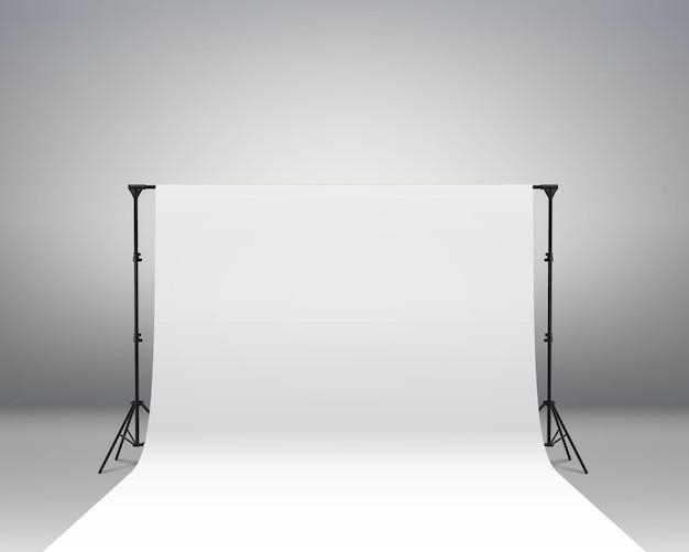 写真撮影のための白い背景の背景写真撮影のための写真ブースの背景画面ビデオ録画パーティーカーテン。プロの写真スタジオのインテリア。写真撮影用三脚とラック。