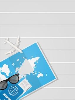 テキストの場所と旅行バナーの白い背景。チケット、パスポート、世界地図、飛行機がテーブルにあります。