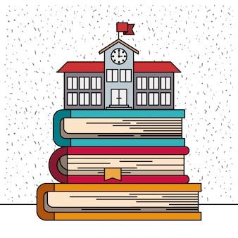 書籍のスタック上の学校buildinfの輝きと白い背景