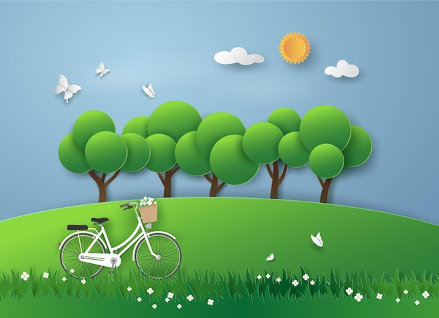 White bicycle on meadow in the garden with the fresh air in landscape view.