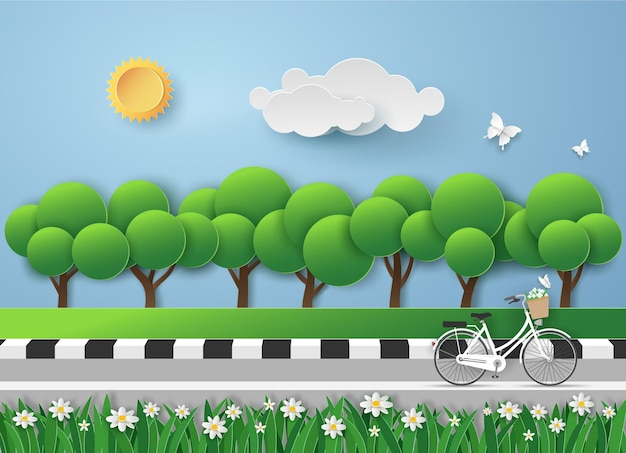White bicycle on road in the garden with the fresh air in landscape view.