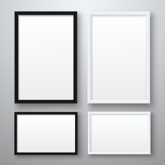 White and black realistic empty pictures frame on gray background