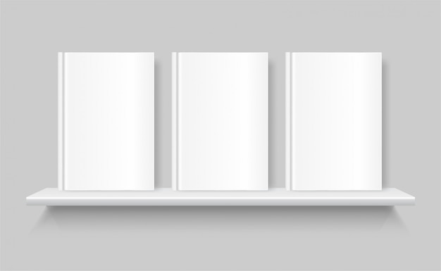 White blank books on a bookshelf. empty cover of book. shelf on the grey wall.