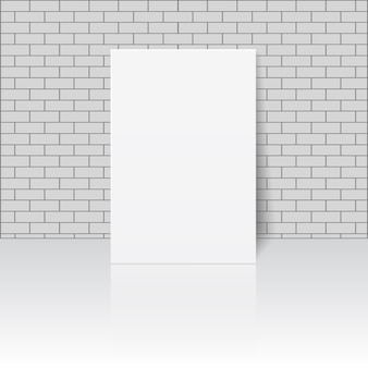 White blank paper sheet or photo frame on masonry wall