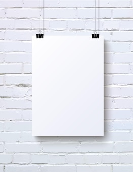 White blank vertical poster mockup on the white brick wall