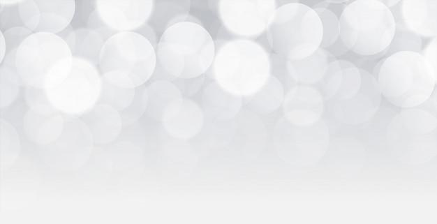 Sfondo bianco bokeh design con lo spazio del testo