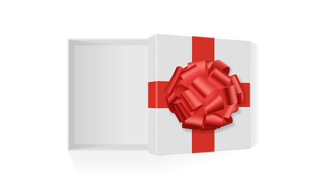 Белая коробка с красным большим подарочным бантом на белом фоне