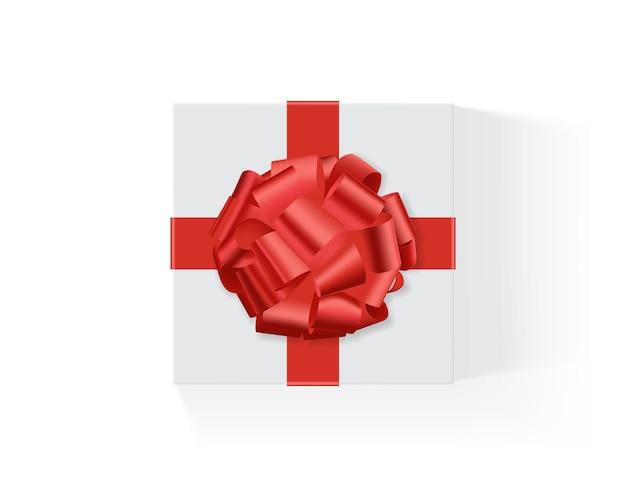 Белая коробка с красным большим подарочным бантом