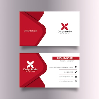 White business card with elegant red details