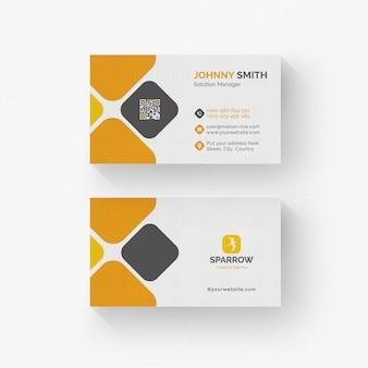 Белая визитка с оранжевыми и серыми деталями