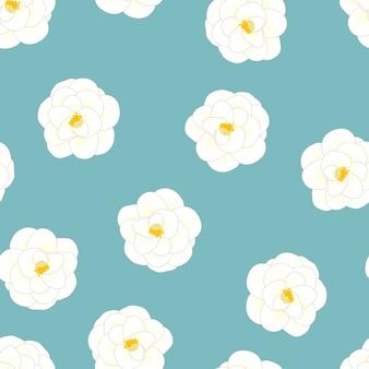 ライトブルーの背景に白いカメリアの花
