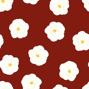 White camellia flower on red background