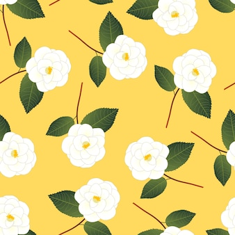 White camellia flower on yellow background