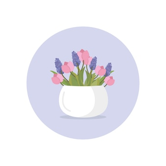 White ceramic vase with fresh tulip and lilac flowers