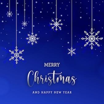 파란색 배경에 눈송이와 화이트 크리스마스 카드