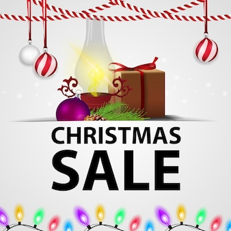 White christmas discount banner with gifts and antique lamp