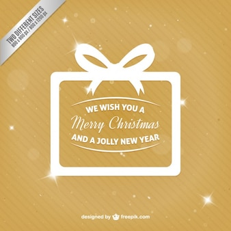 White christmas gift on gold background