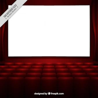 Schermo cinematografico bianco con poltrone