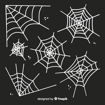 White cobweb silhouette isolated on dark background