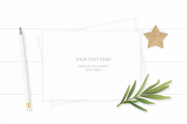 White composition paper with pencil and tarragon leaf on wooden background