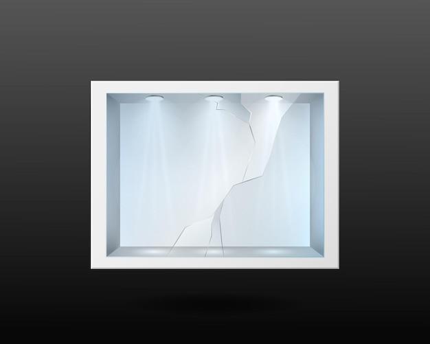 깨진 유리와 내부 조명이 있는 흰색 용기. 가로 균열이 있는 빈 전시