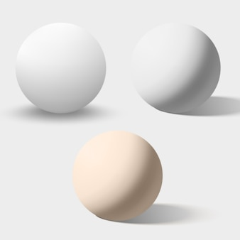White and cream realistic spheres isolated on white