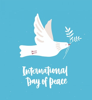 White dove, pigeon or bird flying and carrying olive branch. beautiful symbol of love and pacifism and international day of peace inscription or hand lettering.