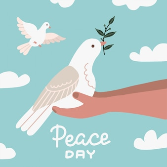 White dove with olive branch sittting in human hands. peace symbol. pigeon isolated logo. white flying bird emblem. flat dove flat sign. peace day illustration with sky and clouds.