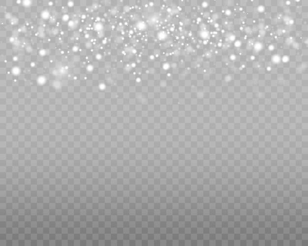 白いほこりは、透明な背景に分離された光の効果、輝き、きらめく魔法のほこりの粒子をスパークします。