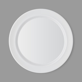 White empty flat round plate isolated, top view