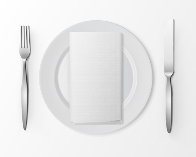 White empty flat round plate with silver fork and knife and white folded rectangular napkin isolated, top view on white.