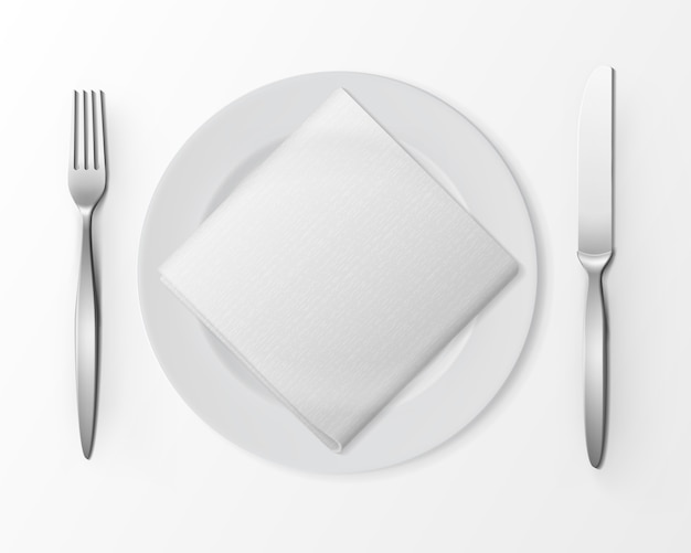White empty flat round plate with silver fork and knife and white folded square napkin isolated, top view on white.