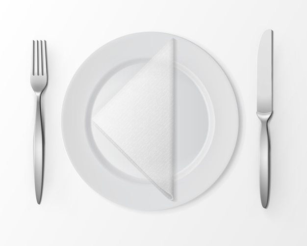 White empty flat round plate with silver fork and knife and white folded triangular napkin isolated, top view on white