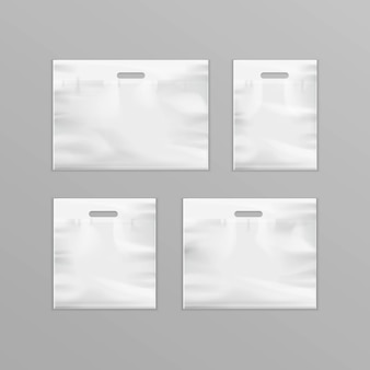 White empty reusable plastic shopping bags with handles for packaging
