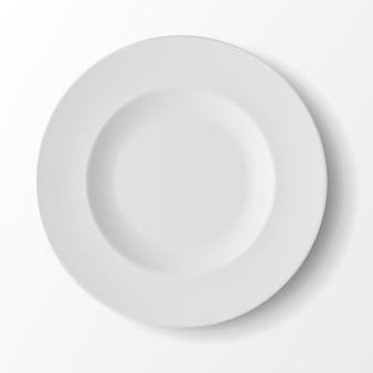 White empty round soup plate on background