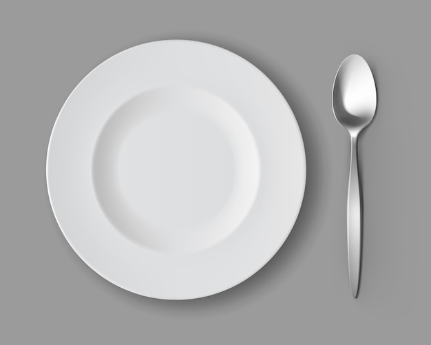 White empty round soup plate with silver table spoon isolated, top view vector