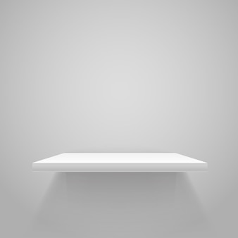 灰色の壁に白い空の棚