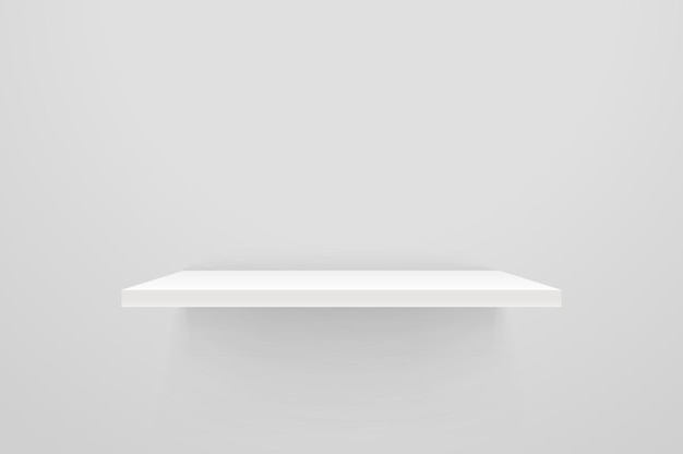 白い壁に白い空の棚