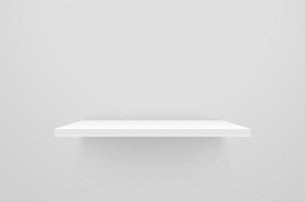 White empty shelf on white wall.