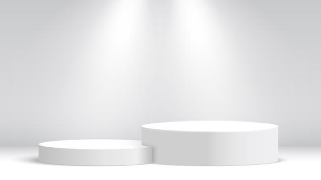 Белый выставочный стенд. подиум и прожекторы. сцена для церемонии награждения. пьедестал.