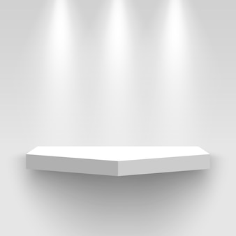 White exhibition stand on wall, illuminated by spotlights. pedestal with shadow. shelf.