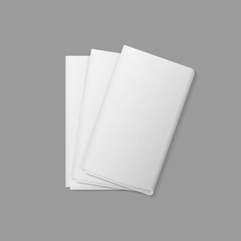 White folded rectangular napkins top view  on  background. table setting