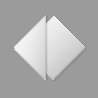 White folded square and triangular napkins top view  on background. table setting