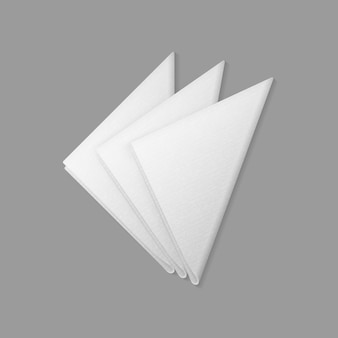 White folded trianglular napkins top view  on  background. table setting