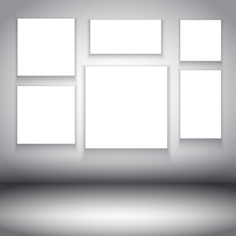 White frames in a gray room