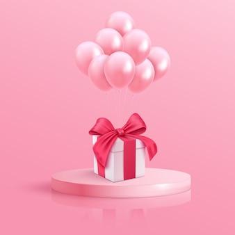 블루 리본 및 분홍색 배경에 풍선 흰색 선물 상자. 최소한의 크리스마스 새해 개념입니다.